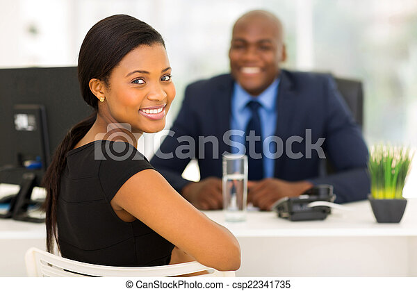 african office worker looking back - csp22341735