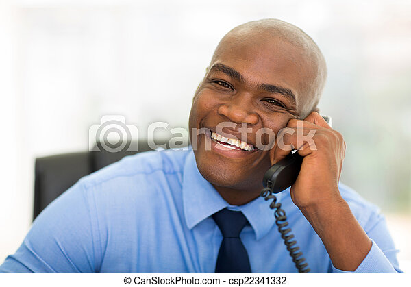 african office worker talking on telephone - csp22341332