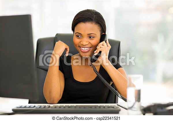 african office worker talking on the phone - csp22341521