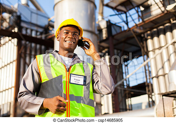 african oil chemical worker talking on cell phone - csp14685905