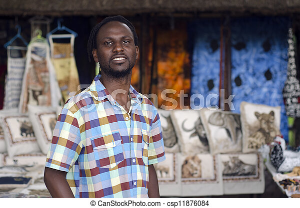 African small business curio salesman selling ethnic items in Howick, KwaZulu-Natal South Africa - csp11876084