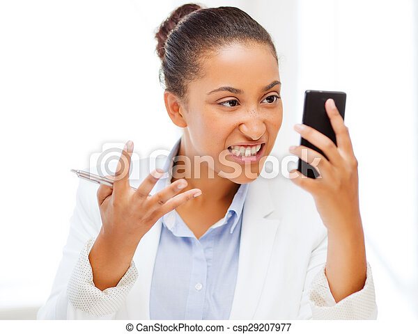 african woman shouting into smartphone - csp29207977