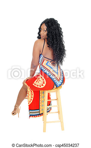 African woman sitting in long dress. - csp45034237