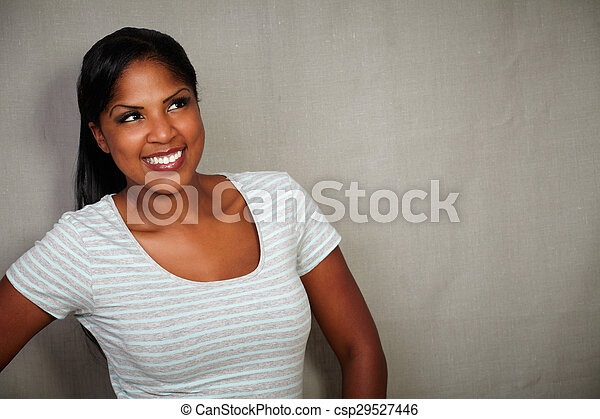 African woman smiling while looking away - csp29527446