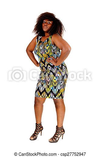 African woman standing in dress. - csp27752947