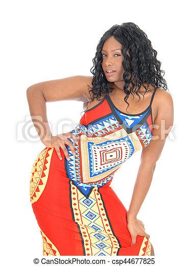 African woman standing in dress. - csp44677825