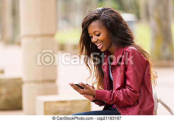 african woman using smart phone - csp21163197