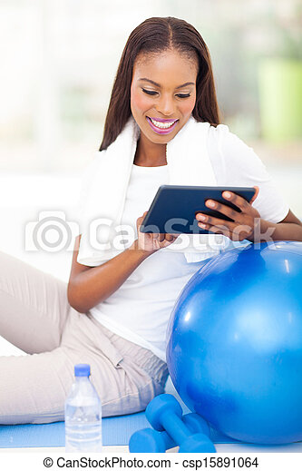 african woman using tablet pc - csp15891064