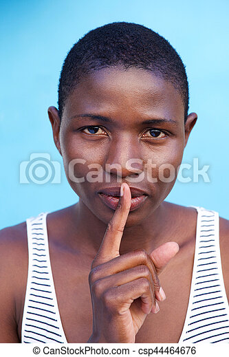african woman with finger to lips - csp44464676