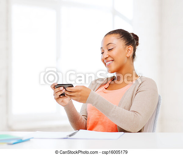 african woman with smartphone in office - csp16005179