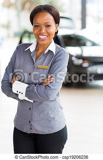 african woman working at car dealership - csp19206236
