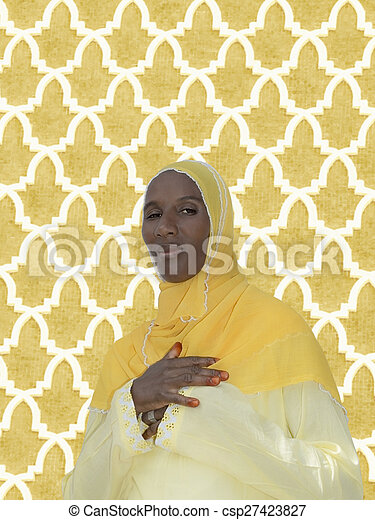 African woman, yellow cotton veil - csp27423827