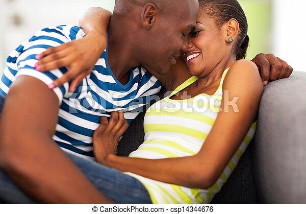 Una pareja africana coqueteando - csp14344676