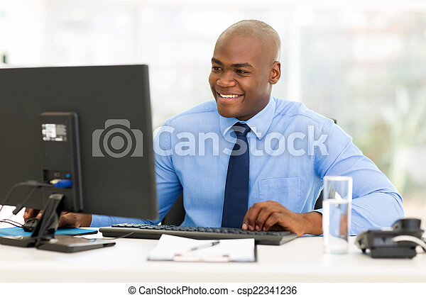 afro american business man using computer - csp22341236
