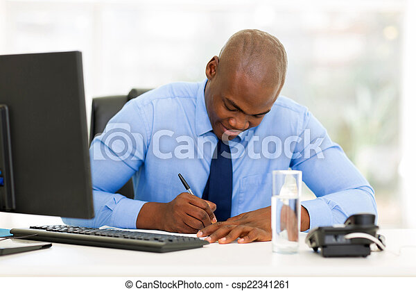 afro american businessman working in office - csp22341261