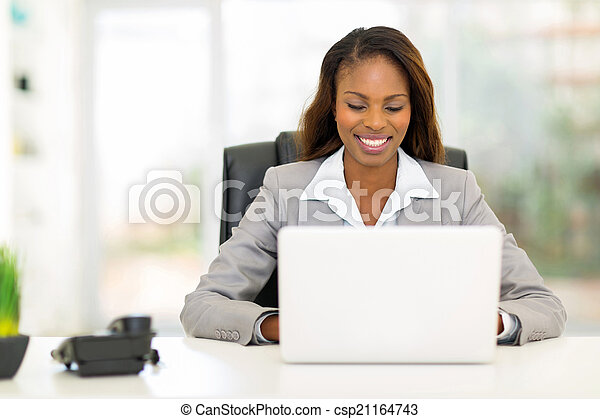afro american businesswoman using laptop computer - csp21164743