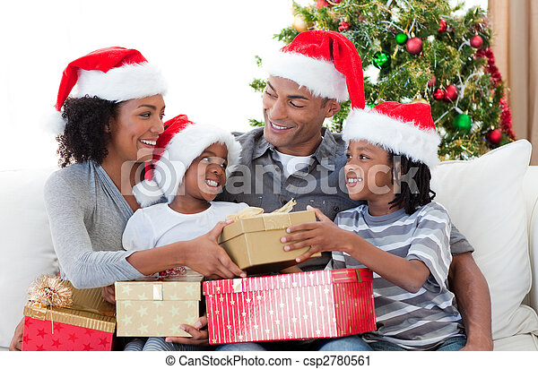 afro american family celebrating christmas at home csp2780561 - Celebrating Christmas