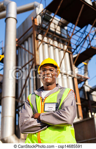 afro american oil industrial worker in refinery plant - csp14685591