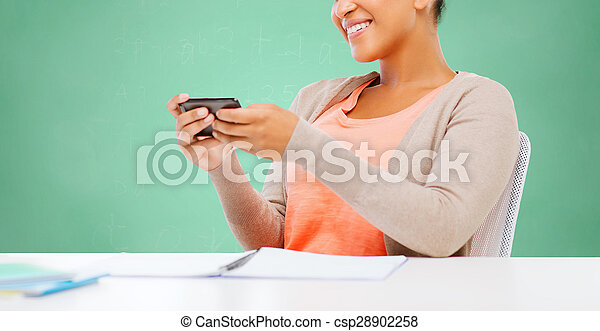 afro american student girl with smartphone - csp28902258