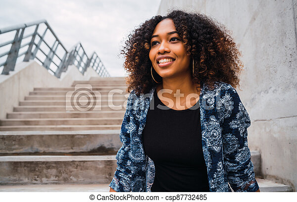 Afro-american woman sitting on steps. - csp87732485
