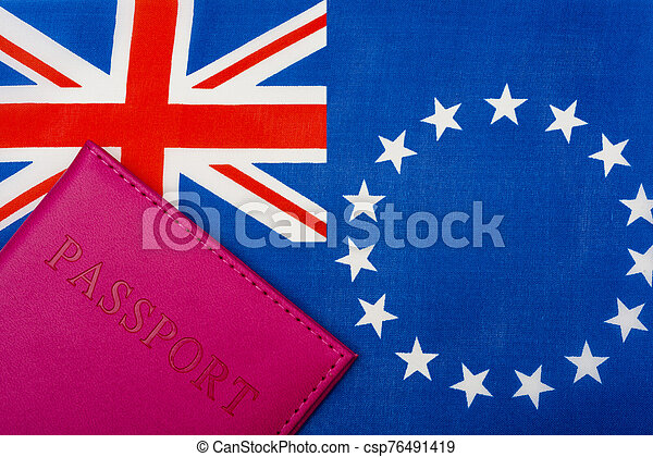 Against the background of the flag of the cook Islands is a passport. - csp76491419