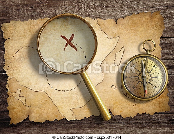 aged antique nautical compass and magnifying glass on table with treasure map - csp25017644
