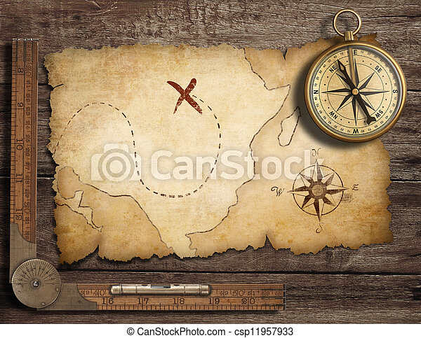 aged brass antique nautical compass on table with old treasure map - csp11957933