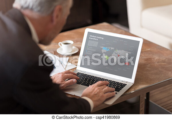 Aged businessman working with the laptop in the hotel - csp41980869