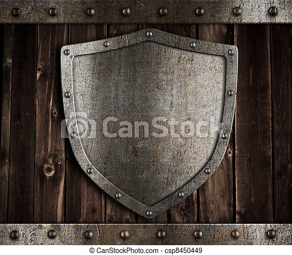 aged metal shield on wooden medieval gates - csp8450449