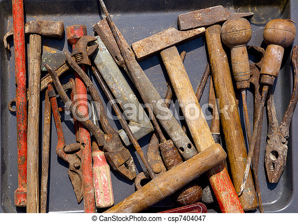 aged weathered rusty hand tools in black - csp7404047