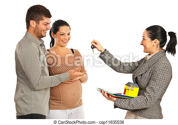 Agent giving house keys to couple - csp11635536