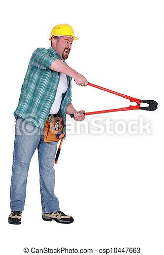 Aggressive man using bolt-cutters - csp10447663
