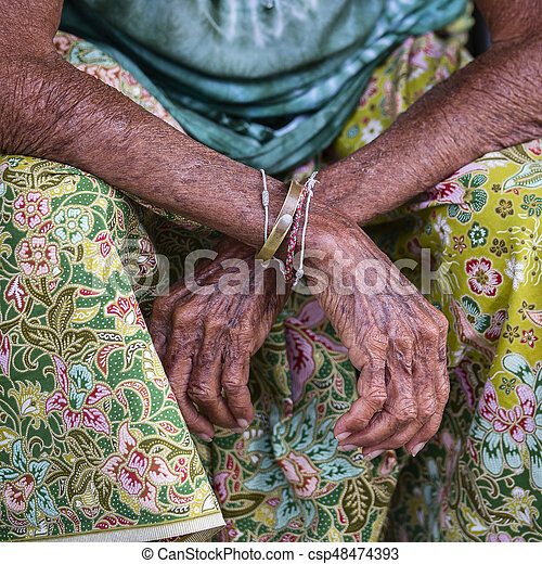 Aging process - very old senior woman hands wrinkled skin, close up. Thailand