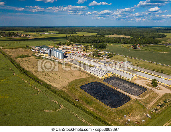 Agricultural , factory aerial view. Green field. - csp58883897