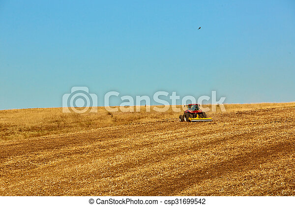 Agricultural Landscape. Tractor working on the field. - csp31699542