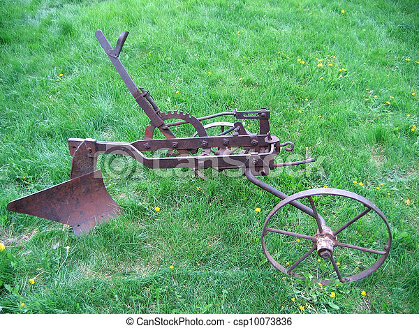 Agricultural Old Plow The Old Farm Hand Plow On The Background Of Green Grass Canstock