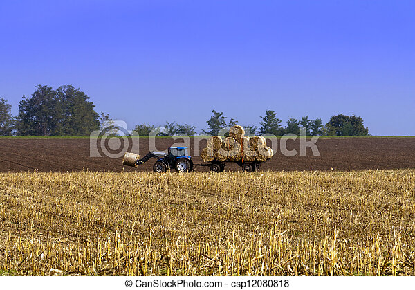 Agricultural tractor working in the field. - csp12080818
