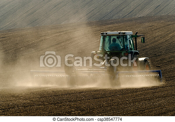 Agricultural tractor working - csp38547774
