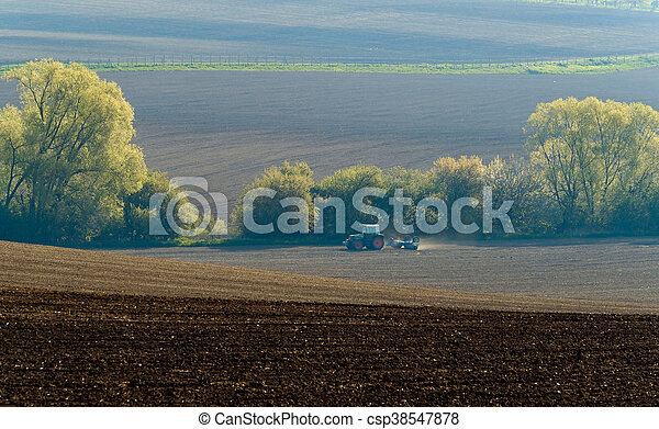 Agricultural tractor working - csp38547878