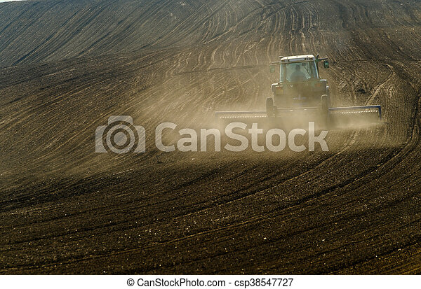 Agricultural tractor working - csp38547727