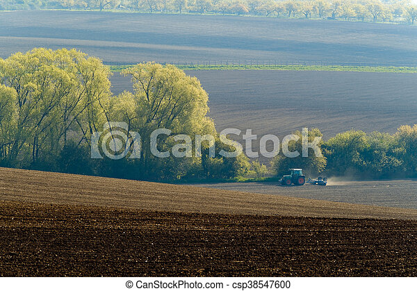 Agricultural tractor working - csp38547600