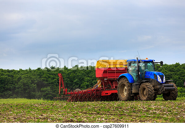 agricultural work plowing land on a powerful tractor - csp27609911