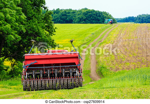 agricultural work plowing land on a powerful tractor - csp27609914