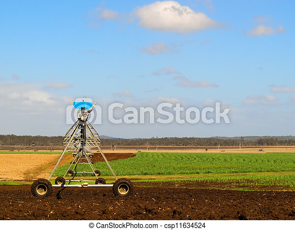 Agriculture Ploughed field with irrigation equipment - csp11634524