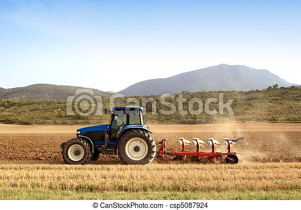 Agriculture plowing tractor on wheat cereal fields - csp5087924