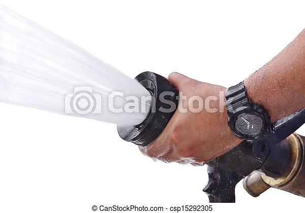 Los bomberos rocían agua durante el tiempo - csp15292305