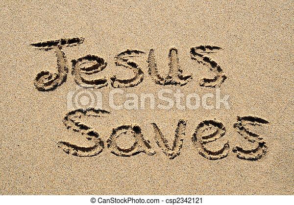 Jesús salva, escrito en una playa de arena. - csp2342121
