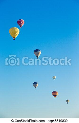 air balloons flying over the valley at Cappadocia - csp48619830