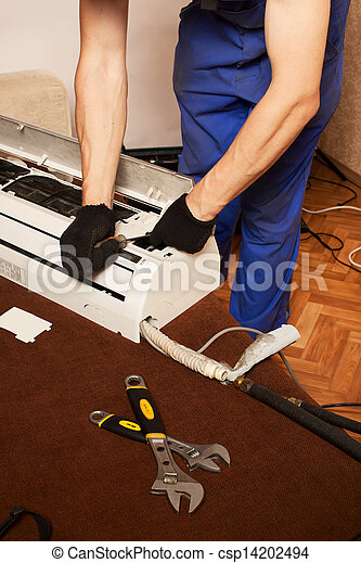 Air conditioning master preparing to install new air conditioner. - csp14202494