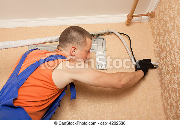 Air conditioning master preparing to install new air conditioner. - csp14202536